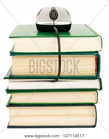 Close up of stack of books and computer mouse on white background