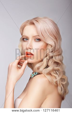 A Blonde Woman With A Gentle Makeup.