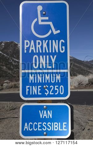 Blue disabled parking only sign with fine