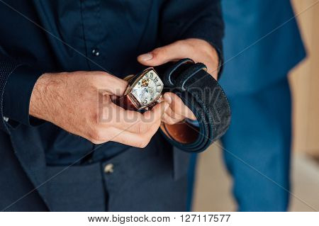 Groom Clasping Stylish Watch Band On His Wrist