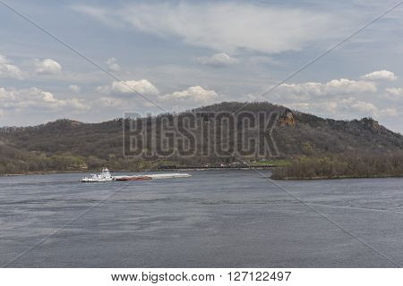 A barge on the Mississippi River during spring.