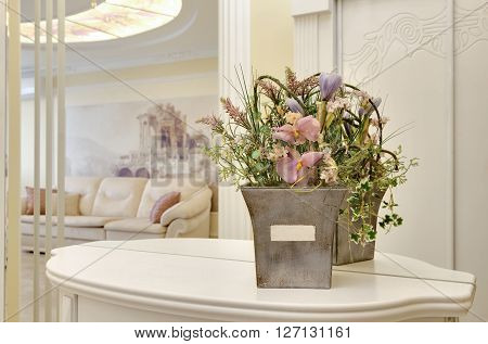 Flowers In A Pot On A Little Table