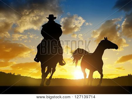 Silhouette cowboy with horse at sunset