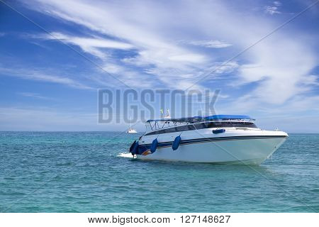 speed boat in tropical sea with sky