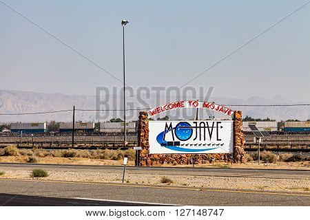 MOJAVE CALIFORNIA - SEPTEMBER 11, 2015: View to the Welcome to Mojave Desert sign on September 11, 2015. Mojave is a town between the desert of Nevada and Los Angeles.