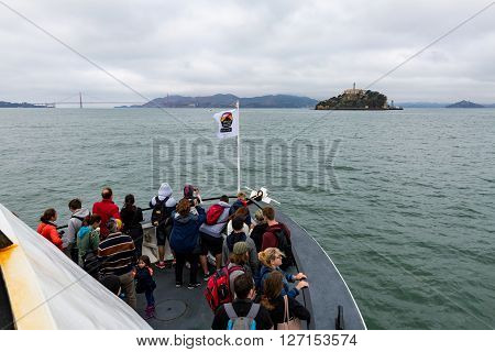 SAN FRANCISCO CALIFORNIA - SEPTEMBER 17: View of the Alcatraz cruize boat and the tourist going to Alcatraz Island on September 17 2015. Alcatraz was a federal prison from 1934 to 1963.