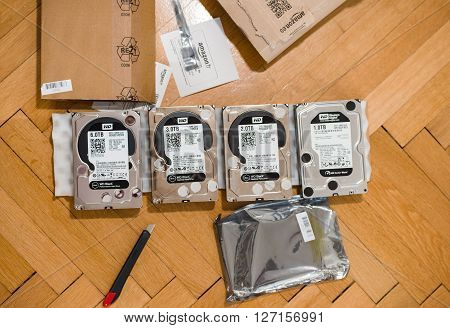 PARIS FRANCE - MAR 18 2016: Multiple Western Digital Hard disk drive with diverse capacity ranging from 1 tb to 6 tb arranged on floor after Amazon.com product e-commerce unboxing