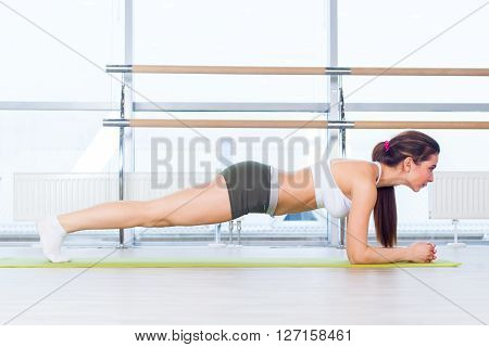 training fitness woman doing plank core exercise working out for back spine and posture Concept pilates sport.