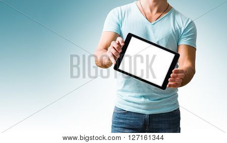 Man showing digital tablet pc screen in hands. Clipping path for display included.