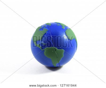 Handheld squishy foam Earth ball, isolated studio shot