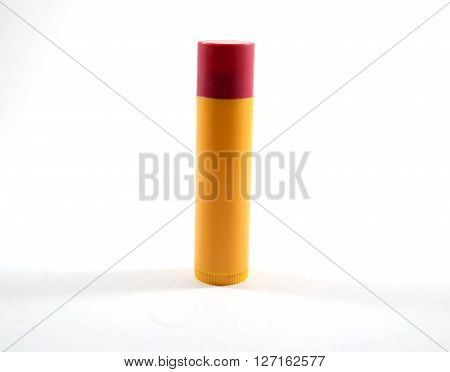 Red flavored chapstick (not branded) with cap on - isolated