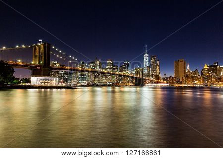 NEW YORK, USA - AUGUST 22, 2015: Views of the Brooklyn Bridge on sunset on August 22 2015. Its a famous and iconic bridge in New York which passes the east river.