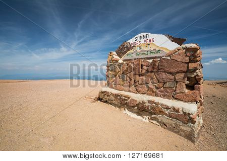 PIKES PEAK COLORADO - AUGUST 26: Views of the Pikes Peak sign plate on top of the mountain on August 26 2015. Pikes Peak is a famous mountain in the Rocky Mountains for hill races and recreation.