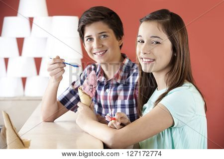 Preteen Brother And Sister Having Strawberry Ice Cream