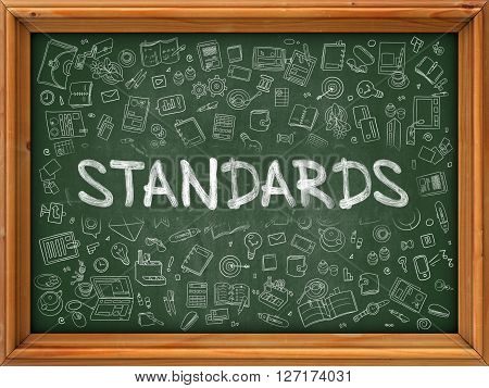 Standards - Handwritten Inscription by Chalk on Green Chalkboard with Doodle Icons Around. Modern Style with Doodle Design Icons. Standards on Background of Green Chalkboard with Wood Border.