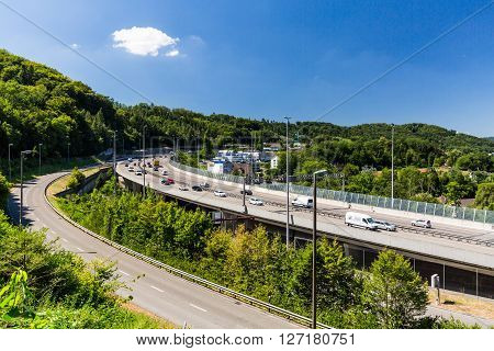 NEUENHOF SWITZERLAND - JULY 21: Views of the motorway A1 near the Baregg Tunnel and the cities of Baden Neuenhof and Wettingen on July 21 2015. The motorway A1 ist the oldest in Switzerland.
