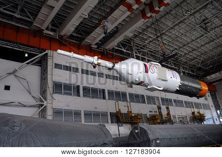 BAIKONUR, KAZAKHSTAN - DECEMBER 18, 2011: Part of Soyuz spacecraft is being relocated inside Integration facility building for further assembly