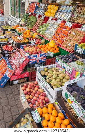 WREXHAM UNITED KINGDOM APRIL 25 2016: Traditional fresh fruit and vegetables pavement display outside a small green grocers shop in the United Kingdom