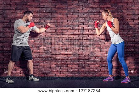 Two figters on the Brick wall background are rady for sparring