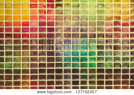 Wall of the plurality of colored squares. Close up photo.