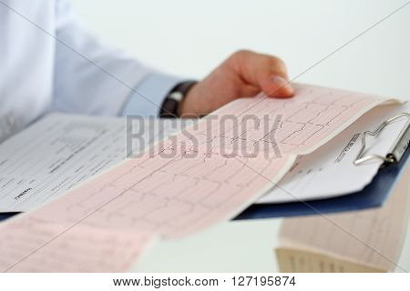 Male Medicine Doctor Hands Holding Cardiogram Chart