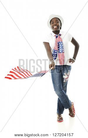 A pretty African American tween waving the American flag while proudly wearing the stars and stripes.  On a white background.