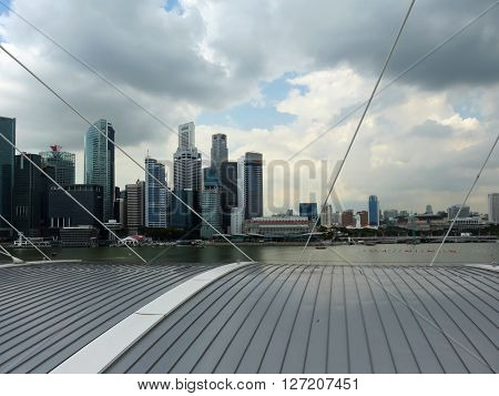 SINGAPORE ASIA - NOVEMBER 22: Cityscape of Singapore business district skyline and pedestrian walkway on Jubilee bridge November 22, 2014 Marina Centre with Marina South in the Marina Bay area in Singapore