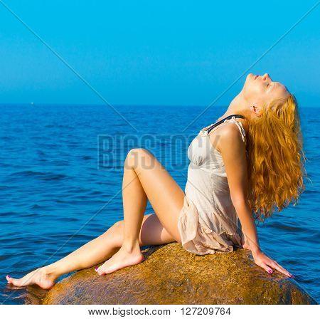Sitting Female Rock