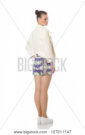 Pretty model wearing purple floral dress isolated on white