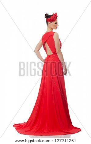 Pretty caucasian model in red long evening dress isolated on whi