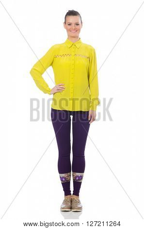 Caucasian model in purple pants and yellow blouse isolated on wh