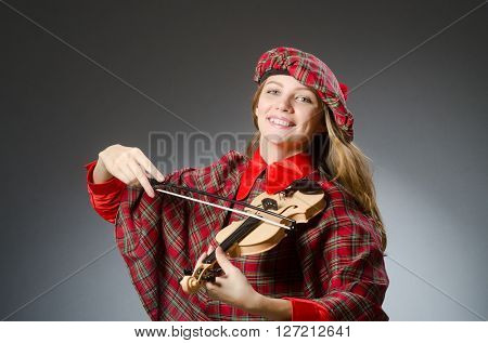 Woman in scottish clothing in musical concept