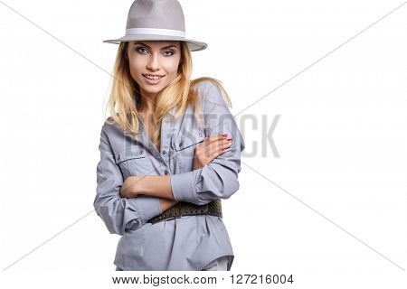 fashion studio portrait of beautiful sensual woman with blond hair with evening makeup with hat