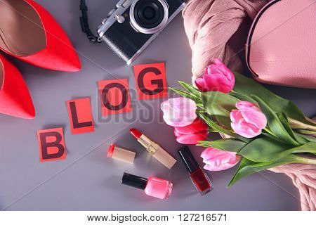 Fashion blog concept. Set of fashion accessories and flowers.