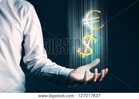 Businessman showing dollar and euro sign in his hand, on dark background