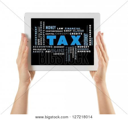 Tax concept. White tablet in hands isolated on white