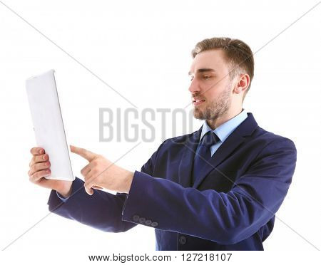 Young man in suit using tablet, isolated on white