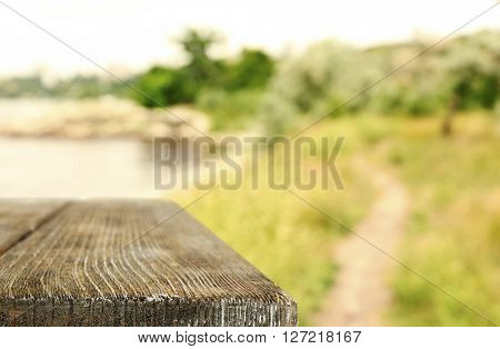 Beautiful spring or summer season abstract nature background with wooden floor