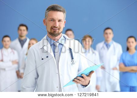 Male doctor with medical team in hospital