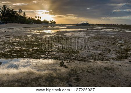 Sunrise and low tide at Panglao island of Philippines