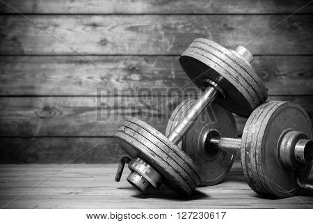 Vintage Dumbbells On The Wooden Floor.