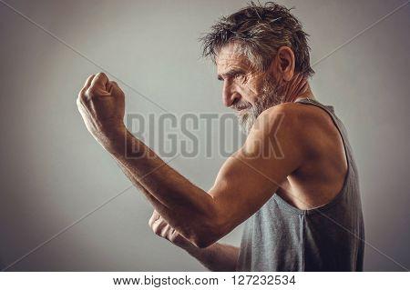 Senior man in fighting position - studio shoot