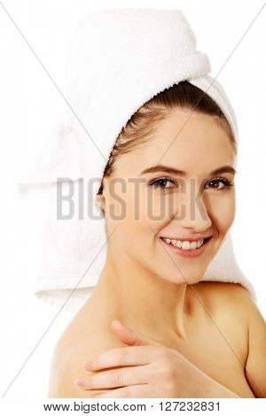 Young happy woman touching her face