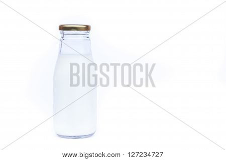 Traditional glass milk bottle on white background, stock photo