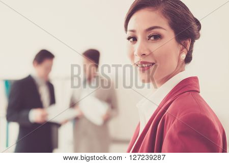 Portrait of attractive business lady smling at camera