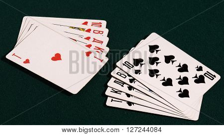 royal flush of playing cards on the table.