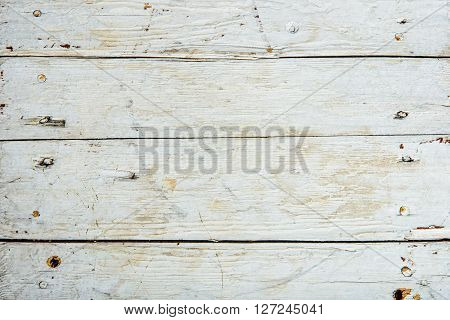 Old wooden board painted white. horizintal texture