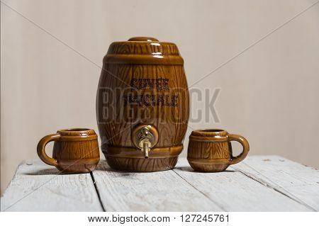 ceramic barrel and mug on the white table