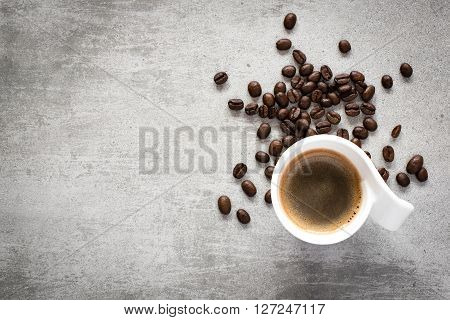 Coffee And Coffee Beans On A Concrete Table