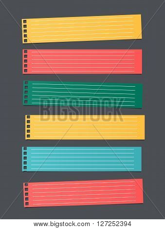 Pieces of cut colorful lined notebook paper, banners are stuck on dark gray background.